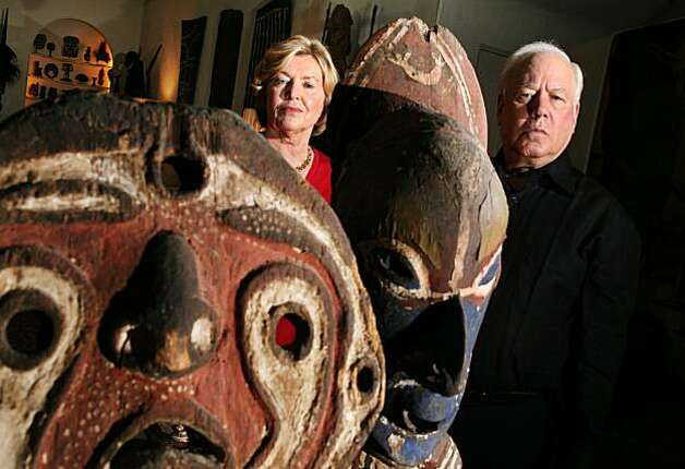 Rye, NY_Nov. 12, 2008_John and Marcia Friede pose in their living room with tribal figures from their 4,000 piece collection of art from Papua New Guinea. The Friedes are embroiled in a lawsuit with two of Mr. Friede's brothers over their mother's estate. The suit may endanger the collection, most of which has been promised to the Fine Arts Museums of San Francisco. Photo: Andrew Sullivan, Special To The Chronicle 2008