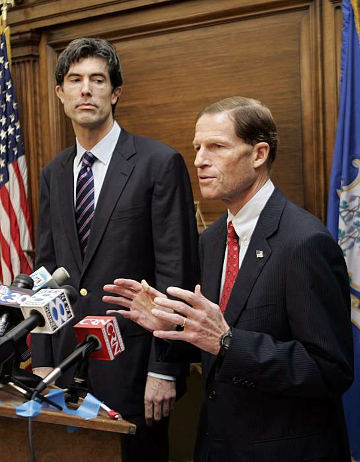 Jim Buckmaster, CEO of Craigslist, watches as Connecticut Attorney General Richard Blumenthal speaks at a news conference in Blumenthal's office in Hartford, Conn., Thursday, Nov. 6, 2008. (AP Photo/Bob Child)