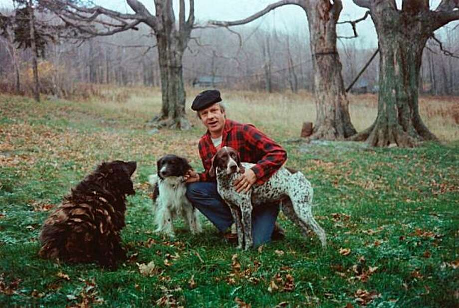 Peter Orlovsky, a poet and longtime companion of Allen Ginsberg, pictured here with his dogs. Photo: Courtesy, Cliff Fyman