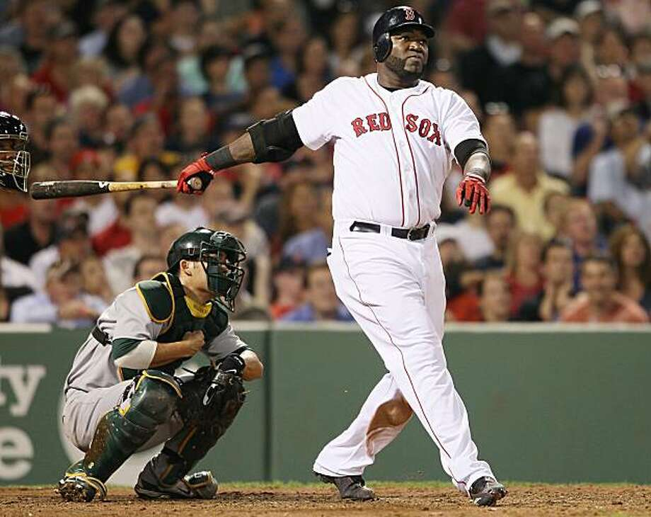 BOSTON - JUNE 02:  David Ortiz #34 of the Boston Red Sox watches his two run homer in the fifith inning as Kurt Suzuki #8 of the Oakland Athletics defends on June 2, 2010 at Fenway Park in Boston, Massachusetts. Photo: Elsa, Getty Images