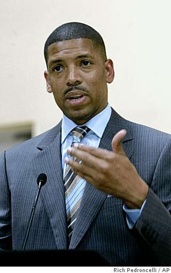 ** FILE ** In this Sept. 26, 2008 file photo, Sacramento mayoral candidate and former NBA star Kevin Johnson responds to a question about the investigation of his nonprofit agency while talking to reporters in Sacramento, Calif.  Johnson, who handed over management responsibilities for St. HOPE this year so he could focus on his campaign, insists he has done nothing wrong.  (AP Photo/Rich Pedroncelli) Photo: Rich Pedroncelli, AP