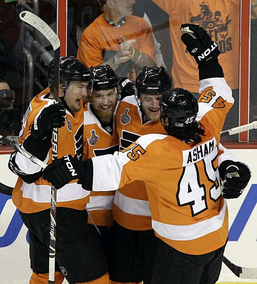 Philadelphia Flyers defenseman Matt Carle, second from right, celebrates with James van Riemsdyk, left, Claude Giroux, second from left, and Arron Asham (45) after Carle scored against the Chicago Blackhawks in the first period of Game 4 of the NHL Stanley Cup hockey finals on Friday, June 4, 2010, in Philadelphia. Photo: Tom Mihalek, AP