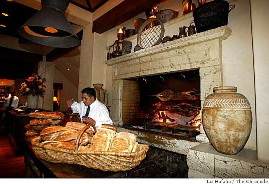 Arni stin souvla being barbecued in the fireplace at Kokkari restaurant in San Francisco, Calif., on Tuesday, October 7, 2008. Photo: Liz Hafalia, The Chronicle