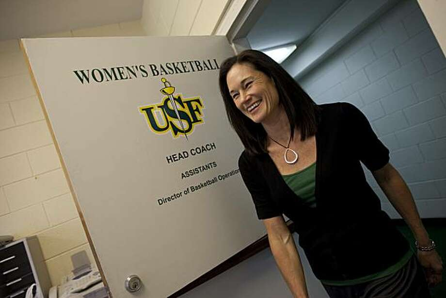 Jennifer Azzi, the new womans basketball coach for the for the University of San Francisco goes over material with her assistants their offices on June 1, 2010 in San Francisco, Calif.  Photograph by David Paul Morris/Special to the Chronicle Photo: David Paul Morris, Special To The Chronicle