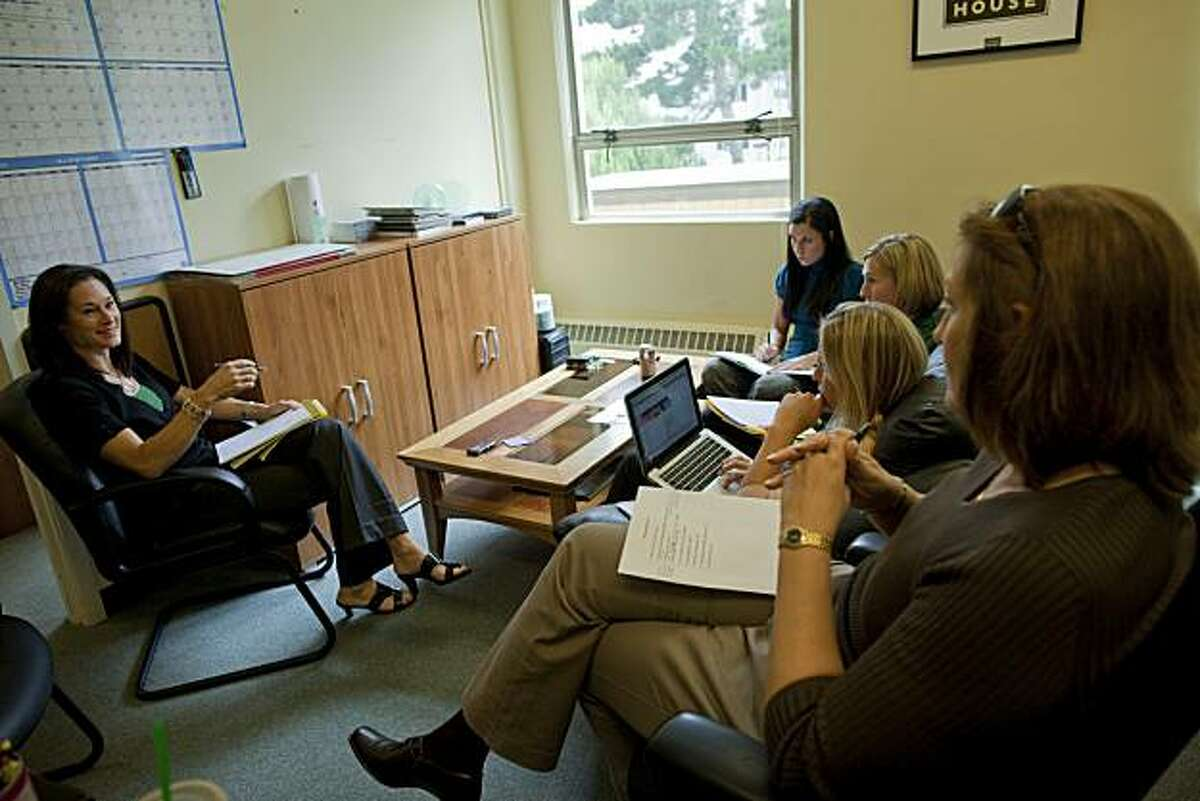 Jennifer Azzi, (L) the new womans basketball coach for the for the University of San Francisco goes over material with her assistants Katy Steding, associate head coach, Molly Marrin, assistant coach and Alex Cribbs, director of operations and Blair Hardiek assiistant coach in their offices on June 1, 2010 in San Francisco, Calif. Photograph by David Paul Morris/Special to the Chronicle