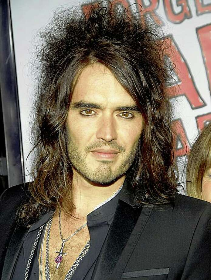 """In this April 10, 2008 file photo,  Russell Brand poses on the press line at the premiere of """"Forgetting Sarah Marshall"""" in Los Angeles. Brand and Jonathan Ross, popular BBC broadcasters, were indefinitely suspended, Wednesday, Oct. 29, 2008, for leaving a series of lewd phone messages on an actor's answering machine. Photo: Dan Steinberg, AP"""