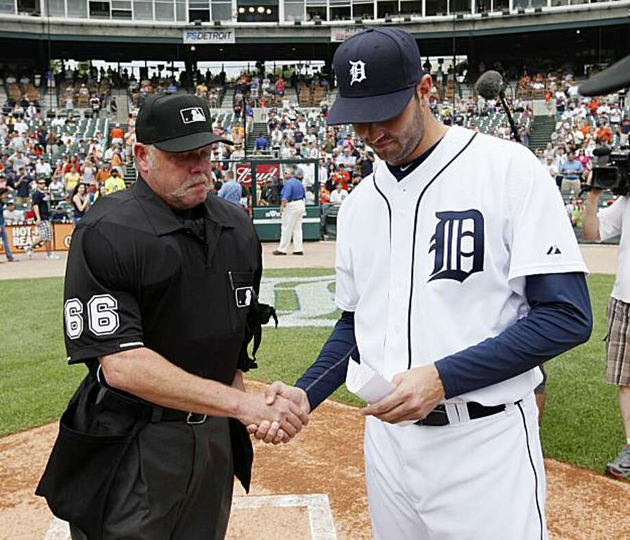Home plate umpire Jim Joyce, left, shakes hands with Detroit Tigers pitcher Armando Galarraga while handing the lineup card on the field before the Detroit Tigers-Cleveland Indians MLB baseball game in Detroit,  Thursday, June 3, 2010. Galarraga lost hisbid for a perfect game with two outs in the ninth inning on a disputed call  at first base by Joyce on Tuesday night. Photo: Paul Sancya, AP
