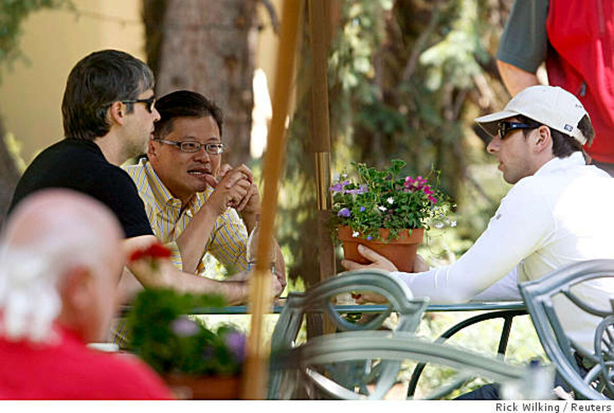 Yahoo! CEO Jerry Yang (C) talks to Google co-founders Larry Page (L) and Sergey Brin at the 26th annual Allen & Co conference in Sun Valley, Idaho July 10, 2008. REUTERS/Rick Wilking (UNITED STATES)