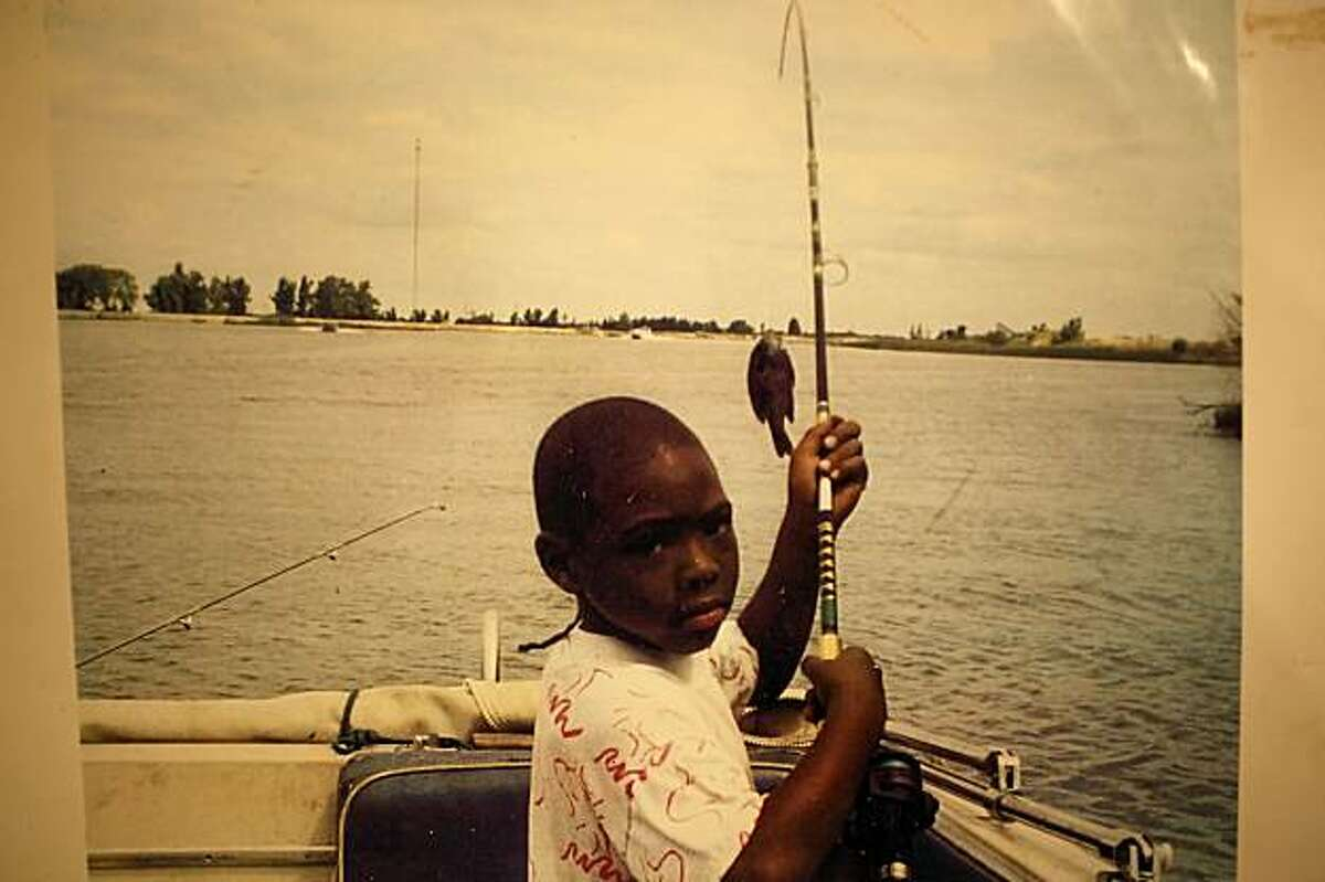 A photo of Oscar Grant at around age 8, fishing on the Delta with his grandfather. Oscar Grant, who was gunned down by a former BART police officer, Johannes Mehserle in January of 2009, is about to go on trial for murder in Los Angeles.