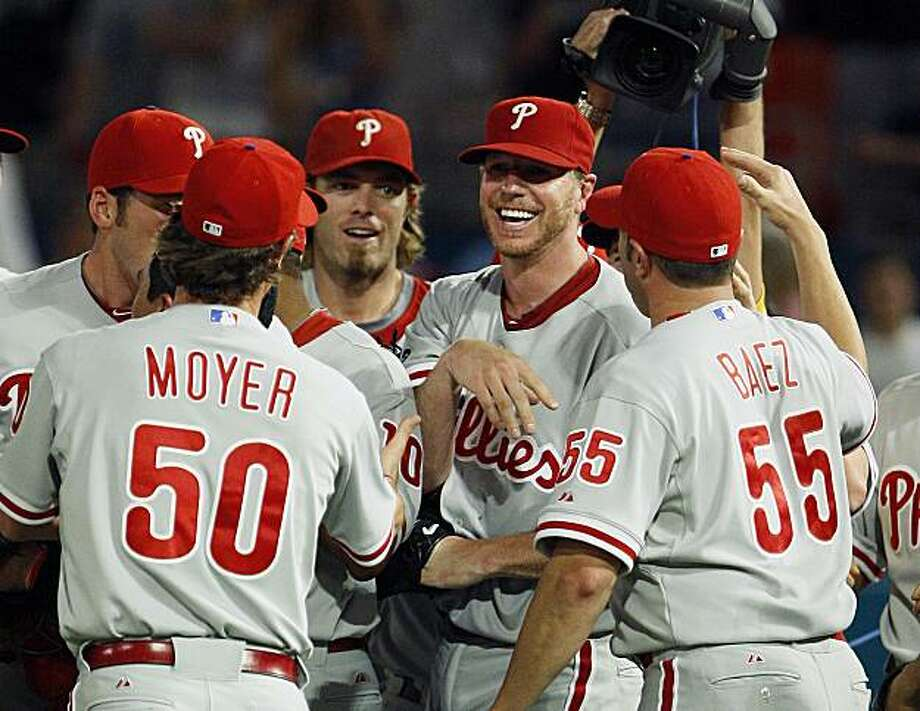 Philadelphia Phillies starting pitcher Roy Halladay, second from right, is mobbed by teammates after throwing a perfect baseball game against the Florida Marlins, Saturday, May 29, 2010, in Miami. The Phillies defeated the Marlins 1-0. Photo: Wilfredo Lee, AP