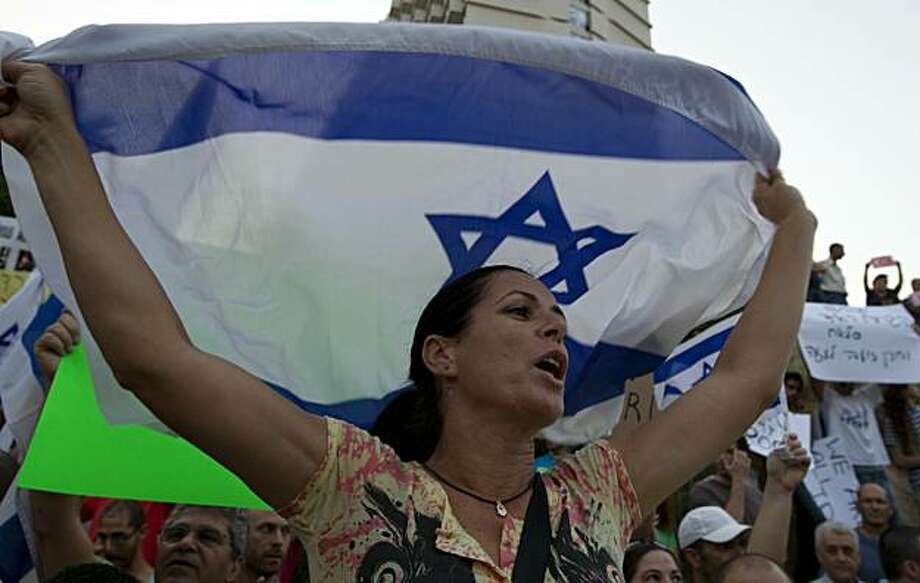 An Israeli woman holds a national flag during a demonstration outside the Turkish ambassy in Tel Aviv on June 3, 2010, as relations between the two countries deteriorated after Israel's May 31 deadly raid on a Gaza-bound aid flotilla in which eight Turksand a US national of Turkish origin were shot dead. Photo: Jack Guez, AFP/Getty Images