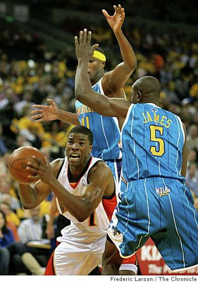 Kelenna Azubuike (7) Golden State Warriors is surrounded by New Orleans Hornets defensive players Mike James (5) and James Posey (41) in the second half at the Oracle Arena in Oakland Calif., on Wednesday October 29, 2008. Photo: Frederic Larson, The Chronicle