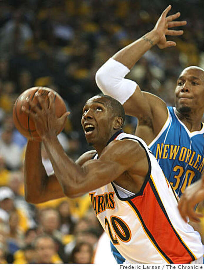 DeMarcus Nelson (20) of the Golden State Warriors get pass New Orleans Hornets David West (30) for a score in the second quearter at the Oracle Arena in Oakland Calif., on Wednesday October 29, 2008. Photo: Frederic Larson, The Chronicle
