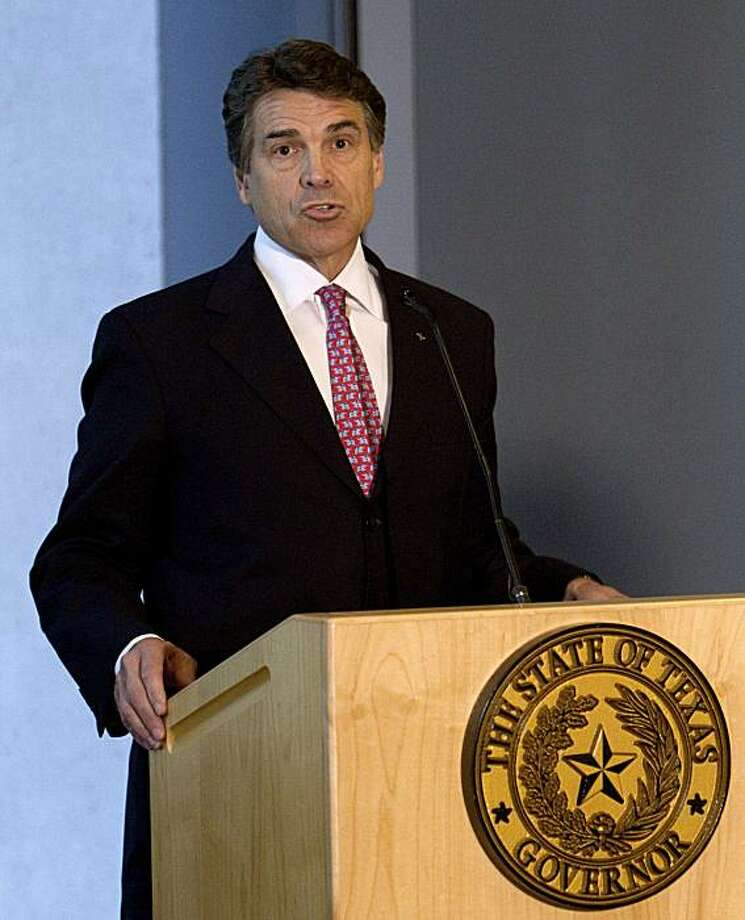 Texas Gov. Rick Perry addresses the media after touring the command center BP has set up in its Houston headquarters on Saturday, May 15, 2010. Perry said it appears chemical dispersants being applied at the leak point are working.  The oil slick polluting the waters of the Gulf of Mexico remains at least 150 miles from Texas waters and is not making much progress toward the state's coastline,  Perry said on Saturday. Photo: Bob Levey, AP