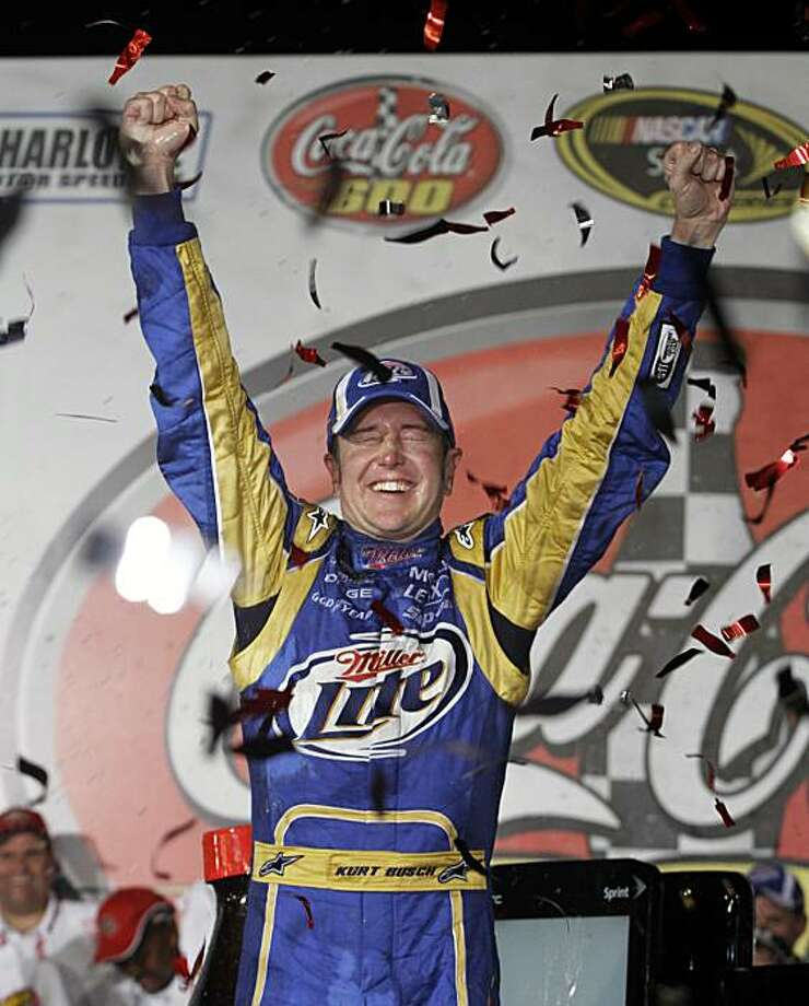 Kurt Busch celebrates in victory lane after winning the NASCAR Sprint Cup Series' Coca-Cola 600 auto race at Charlotte Motor Speedway in Concord, N.C., Sunday, May 30, 2010. Photo: Terry Renna, AP