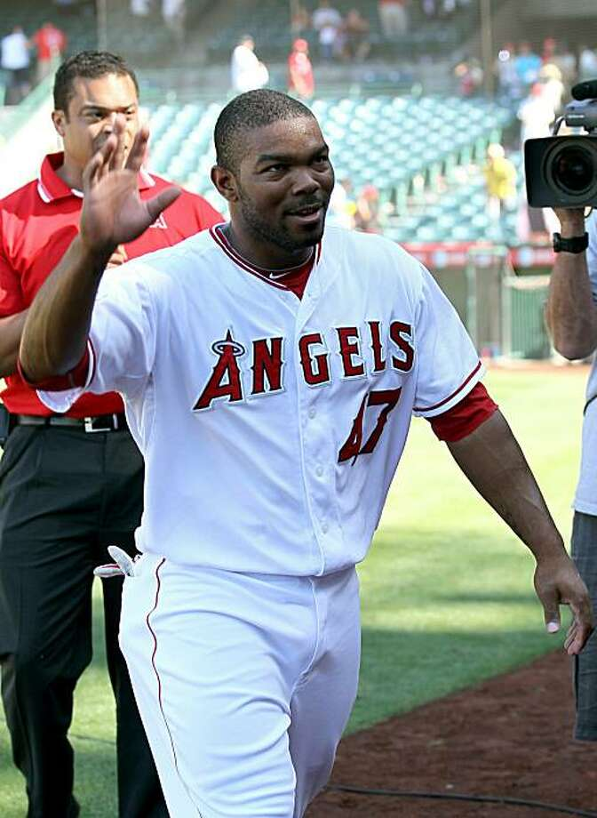 ANAHEIM, CA - MAY 30: Howie Kendrick #47 of the Los Angeles Angels of Anaheim waves as he leaves the field after his three run walk off home run in the ninth inning against the Seattle Mariners on May 30, 2010 at Angel Stadium in Anaheim, California.  TheAngels won 9-7. Photo: Stephen Dunn, Getty Images