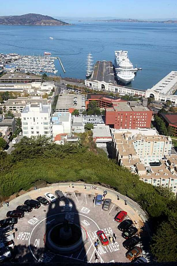 Coit Tower's shadow looms over the parking lot on Telegraph Hill. The venerable San Francisco icon is celebrating its 75th Anniversary on Saturday.. Photo: Liz Hafalia, The Chronicle