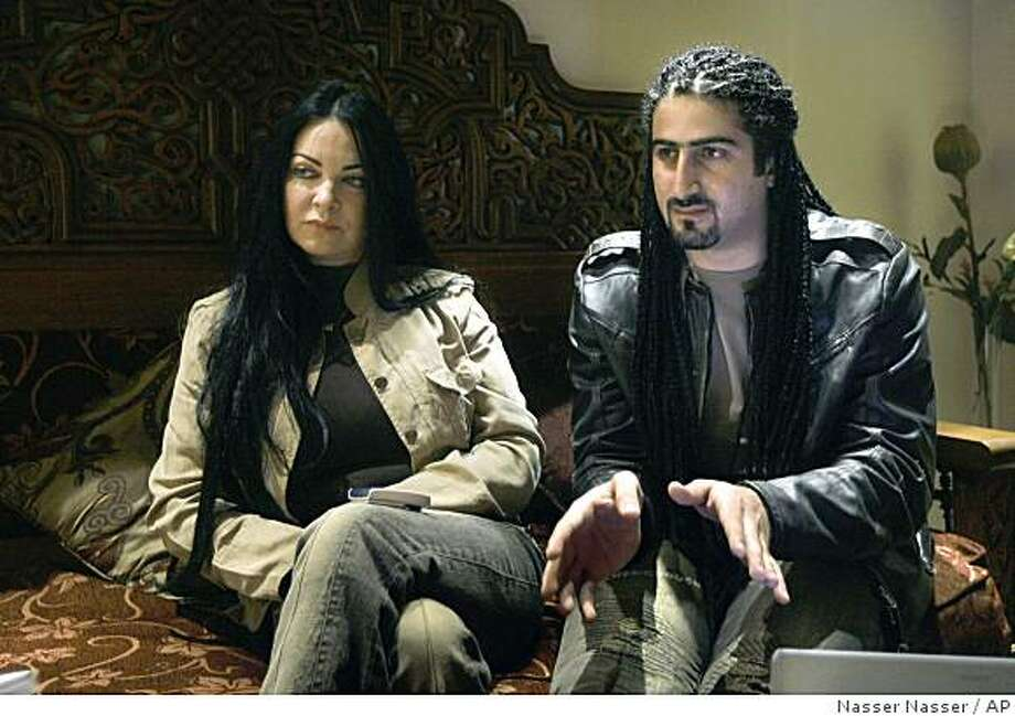"""** FILE ** In this file photo dated Jan. 11, 2008, Omar Osama bin Laden, right, and his British-born wife Jane Felix-Brown, now known as Zaina Alsabah, speak during an interview with The Associated Press in Cairo, Egypt. Omar Osama bin Laden, 27, asked for asylum upon arriving Monday at Madrid's airport on a flight stopping over from Cairo, Egypt, en route to Casablanca, Morocco, an Interior Ministry official said on Tuesday, Nov. 4, 2008. Omar, one of al-Qaida leader Osama bin Laden's 19 children, is a metals trader who lives in Cairo with his British-born wife. He has not renounced his father, but has said he wants to be an """"ambassador for peace"""" between Muslims and the West. (AP Photo/Nasser Nasser, File) Photo: Nasser Nasser, AP"""