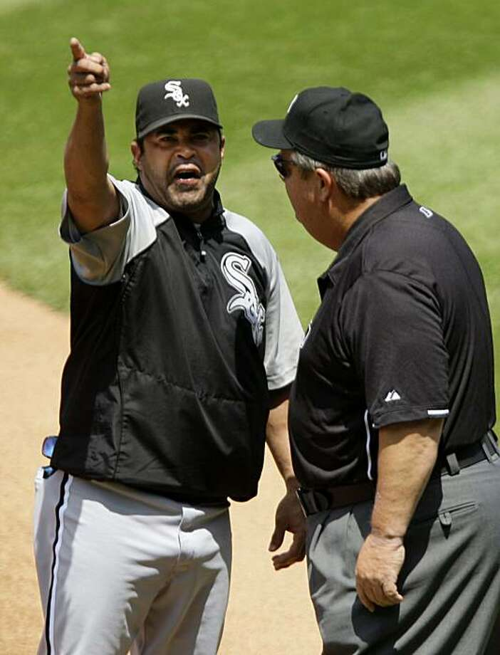 Chicago White Sox manager Ozzie Guillen, left, argues with umpire Joe West after Guillen was ejected from a baseball game against the Cleveland Indians in the second inning Wednesday, May 26, 2010, in Cleveland. Guillen was tossed when he came out of thedugout to argue a balk call on starting pitcher Mark Buehrle. Photo: Mark Duncan, AP