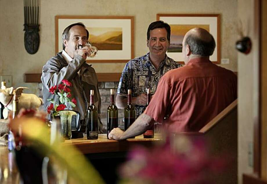 Tastingroom manager Ted Aff (right) attends to customers with his knowledge of wine and the Russian River Valley. Woodenhead Winery has one of only two tasting rooms on River Road on the way to Guerneville in Sonoma County. Photo: Brant Ward, The Chronicle