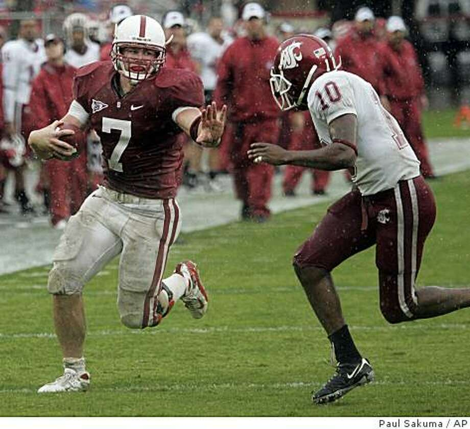 Stanford running back Toby Gerhart (7) prepares to fend off Washington State cornerback Romeo Pellum (10) on the way to a touchdown in the second quarter of an NCAA college football game in Stanford, Calif., Saturday, Nov. 1, 2008. (AP Photo/Paul Sakuma) Photo: Paul Sakuma, AP