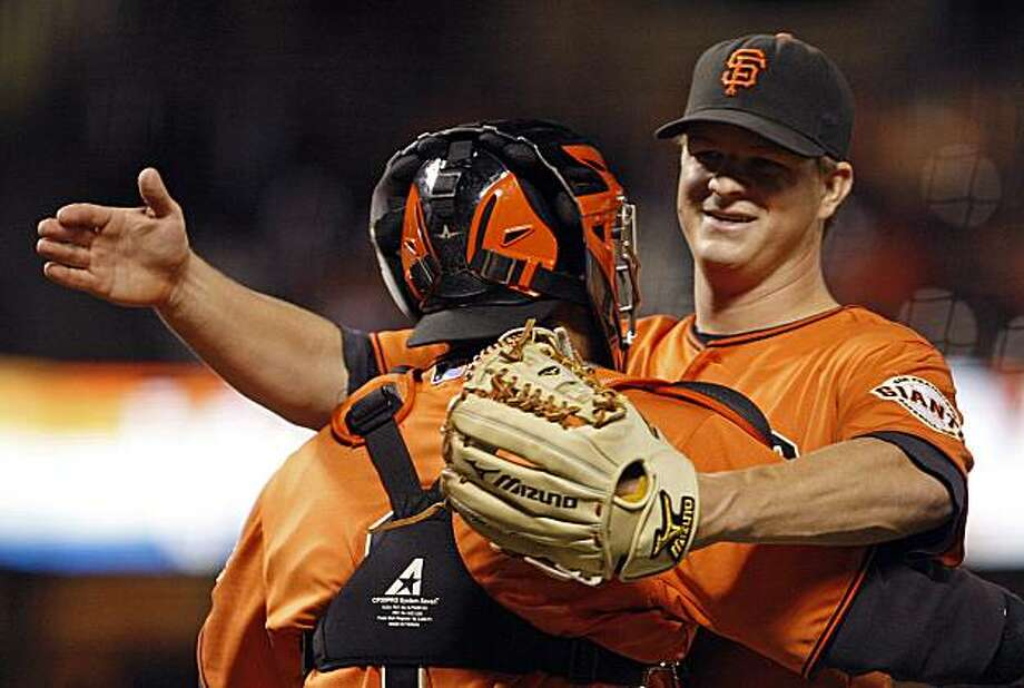 San Francisco Giants' Matt Cain, right, is embraced by catcher Bengie Molina after pitching a complete game one hit shutout at the end of a baseball against the Arizona Diamondbacks Friday, May 28, 2010, in San Francisco. Photo: Ben Margot, AP