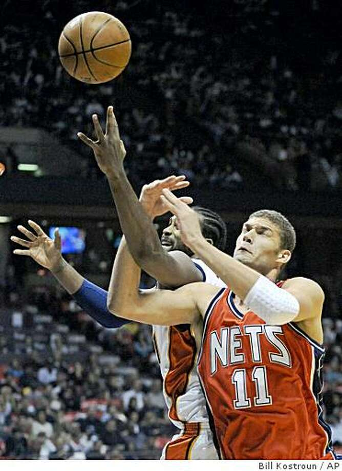 New Jersey Nets center Brook Lopez (11) battles for a rebound with Golden State Warriors forward Ronny Turiaf during the first quarter of an NBA basketball game Saturday night, Nov. 1, 2008, in East Rutherford, N.J.  (AP Photo/Bill Kostroun) Photo: Bill Kostroun, AP