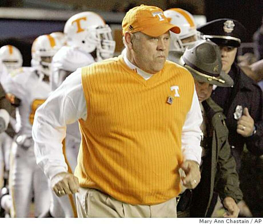 Tennessee coach Phillip Fullmer trots onto the field before an NCAA college football game against South Carolina on Saturday, Nov. 1, 2008, at Williams-Brice Stadium in Columbia, S.C. (AP Photo/Mary Ann Chastain) Photo: Mary Ann Chastain, AP