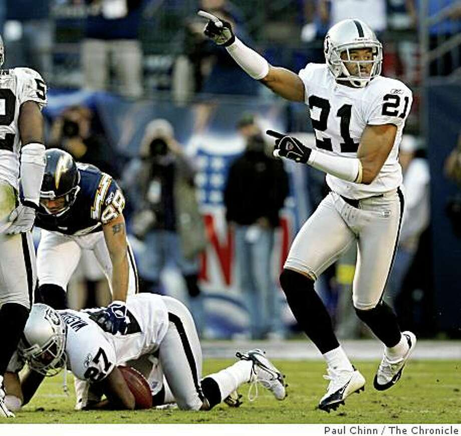 Nnamdi Asomugha (21) and the Raiders think Fabian Washington (27) has recovered a fumble but the referees went back-and-forth before awarding the ball to the Chargers in the fourth quarter of the Oakland Raiders vs. San Diego Chargers game at Qualcomm Stadium in San Diego, Calif. on Sunday, Nov. 26, 2006. San Diego beat Oakland 21-14. Photo: Paul Chinn, The Chronicle