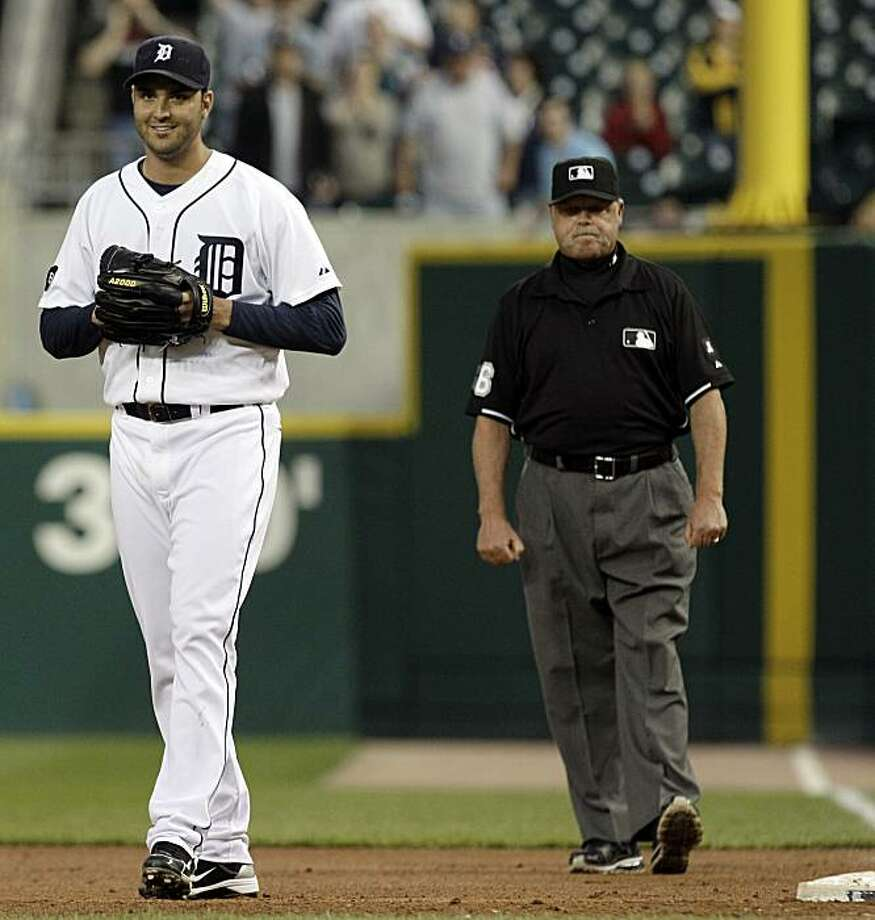 Detroit Tigers pitcher Armando Galarraga, left, smiles as he walks away from first base umpire Jim Joyce, right, who called Cleveland Indians' Jason Donald safe at first base in the ninth inning of a baseball game in Detroit, Wednesday, June 2, 2010. Galarraga lost his bid for a perfect game with two outs in the ninth inning on the disputed call at first base. Detroit won 3-0. Photo: Paul Sancya, AP