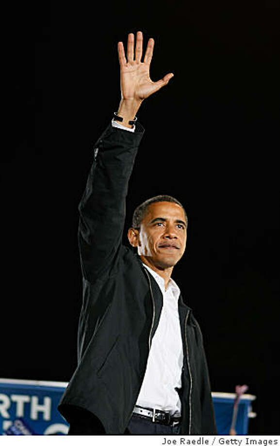CHARLOTTE, NC- NOVEMBER 03:  Democratic presidential nominee U.S. Sen. Barack Obama (D-IL) waves after crying while speaking about his grandmother during a rally at University of North Carolina on November 3, 2008 in Charlotte, North Carolina. Madelyn Dunham, grandmother of Obama, died today of cancer at age 86. Obama continues to campaigns on the eve of Election day with the polls still showing him leading in the race against the Republican presidential nominee U.S. Sen. John McCain (R-AZ).  (Photo by Joe Raedle/Getty Images) Photo: Joe Raedle, Getty Images