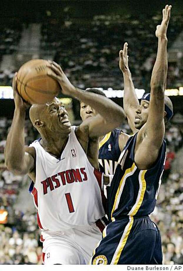 Detroit Pistons' Chauncey Billups (1) looks to shoot as Indiana Pacers' T.J. Ford, right, defends in the first half of an NBA basketball game Wednesday, Oct. 29, 2008, in Auburn Hills, Mich. (AP Photo/Duane Burleson) Photo: Duane Burleson, AP
