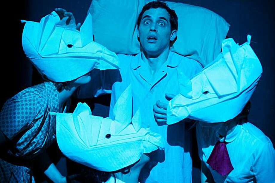 """Ross Pasquale and a nightmare of rhino masks in Boxcar Theatre's """"Rhino."""" Photo: Peter M. Liu"""