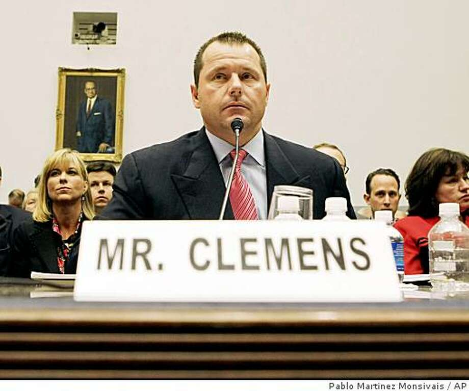 """**FILE** In this Feb. 13, 2008 file photo, Former New York Yankees baseball pitcher Roger Clemens testifies before the House Oversight, and Government Reform Committee on Capitol Hill in Washington. A federal judge said Monday he is """"agonizing"""" over the status of a defamation lawsuit Clemens filed against his former personal trainer, who accused the pitcher of using performance-enhancing drugs. (AP Photo/Pablo Martinez Monsivais, File) Photo: Pablo Martinez Monsivais, AP"""