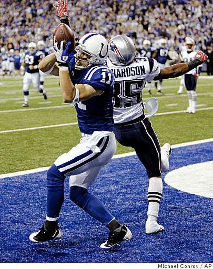 Indianapolis Colts wide receiver Anthony Gonzalez, left, makes a touchdown catch over New England Patriots defensive back Mike Richardson in the third quarter of an NFL football game in Indianapolis, Sunday, Nov. 2, 2008.  (AP Photo/Michael Conroy) Photo: Michael Conroy, AP
