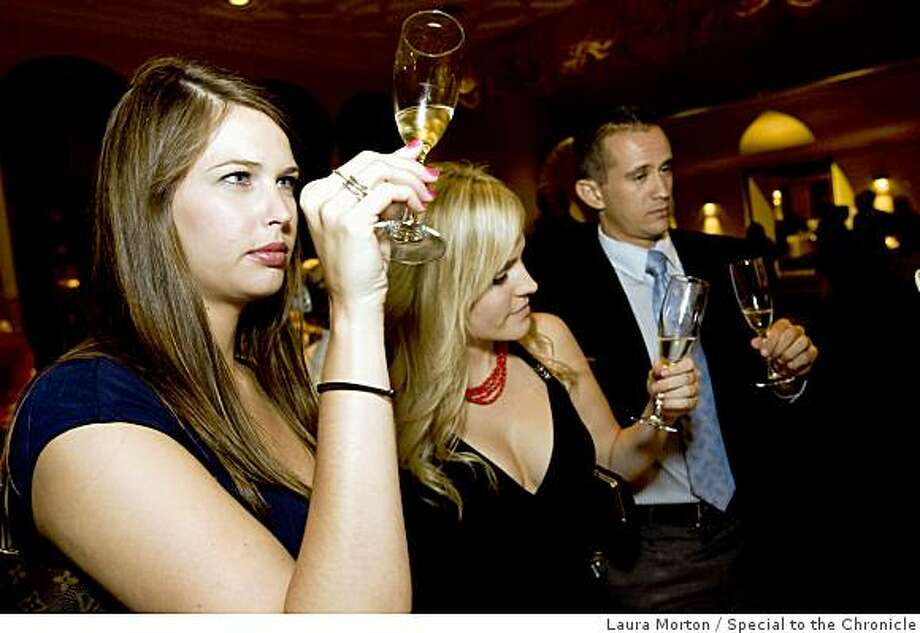 Kate Loper, Stephanie Wagner and Trevor Hammound (left to right) learn how to judge champagne while attending the Tour de Champagne, a champagne tasting event at the Mark Hopkins Hotel, in San Francisco, Calif., on Friday, October 3, 2008. The event was a fundraiser for the Cystic Fibrosis Foundation. Photo: Laura Morton, Special To The Chronicle