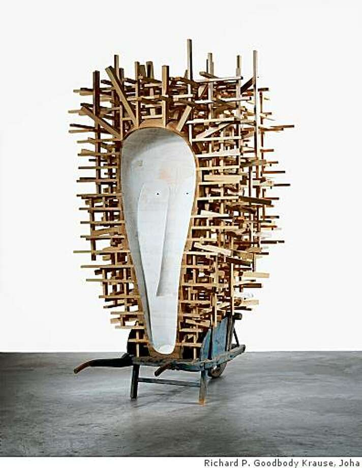 "Martin Puryear, C.F.A.O., 2006-7; Painted and unpainted pine and found wheelbarrow, 8' 4 3/4"" x 6' 5 1/2"" x 61"" (255.9 x 196.9 x 154.9 cm); The Museum of Modern Art, New York; Gift of Sid Bass, Leon D. Black, Donald L. Bryant, Jr., Kathy and Richard S. Fuld, Jr., Agnes Gund, Mimi Haas, Marie-Jos�e and Henry R. Kravis, Jo Carole and Ronald S. Lauder, Donald B. Marron and Jerry Speyer on behalf of the Committee on Painting and Sculpture in honor of John Elderfield; � 2007 Martin Puryear; MAR-44 Photo: Richard P. Goodbody Krause, Joha"