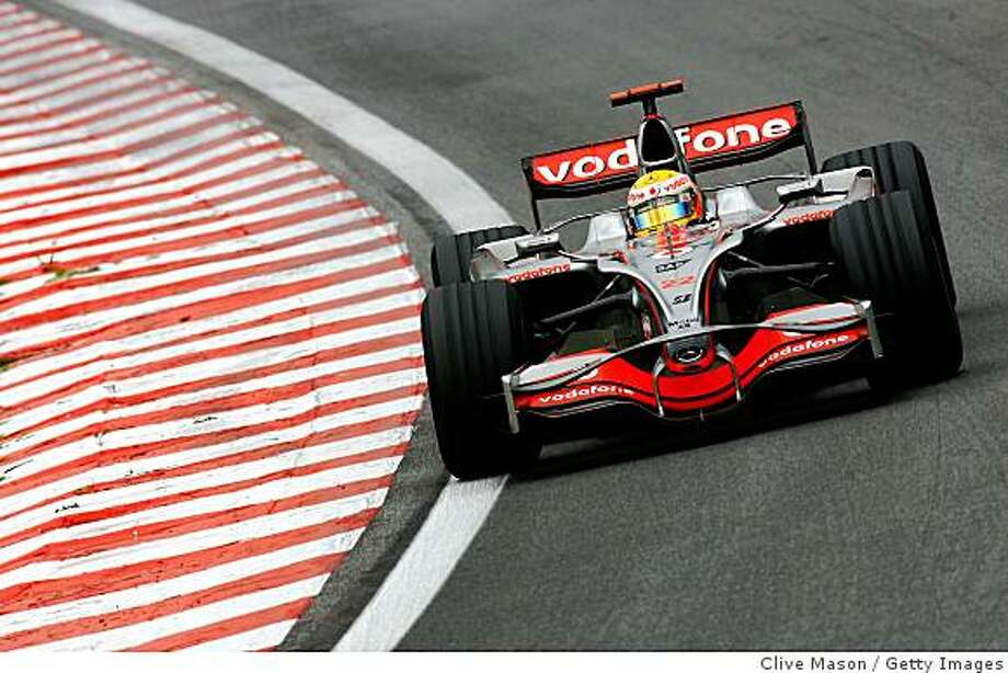 SAO PAULO, BRAZIL - NOVEMBER 02:  Lewis Hamilton of Great Britain and McLaren Mercedes drives on his way to winning the Formula One World Championship during the Brazilian Formula One Grand Prix at the Interlagos Circuit on November 2, 2008 in Sao Paulo, Brazil.  (Photo by Clive Mason/Getty Images) Photo: Clive Mason, Getty Images