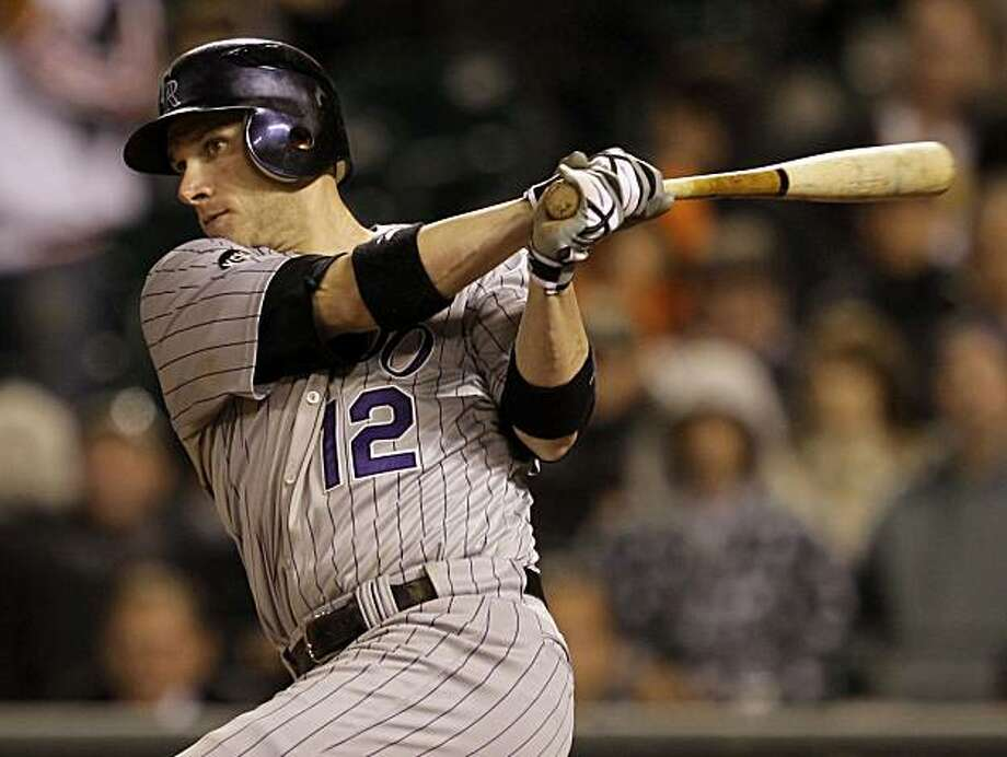 Colorado Rockies' Clint Barmes drives in the game-winning run with a double off San Francisco Giants reliever Santiago Casillas during the 11th inning of a baseball game in San Francisco,  Tuesday, June 1, 2010. Colorado won 2-1. Photo: Marcio Jose Sanchez, AP
