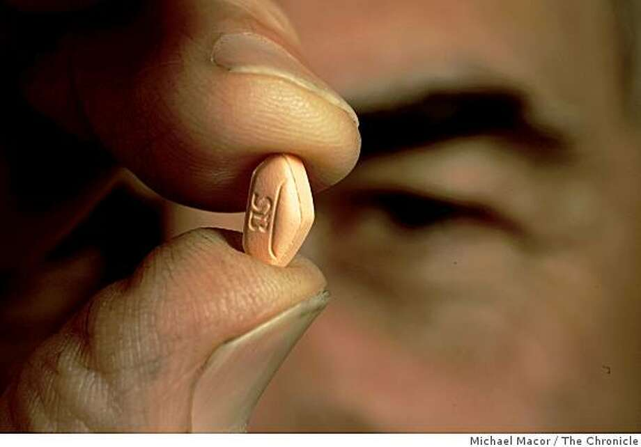 Holding the tiny Avandia pill that has given Mike Seufere so many health problems, Seuferer in his Berkeley, Calif. home  on Thursday  Oct. 30, 2008. Photo: Michael Macor, The Chronicle