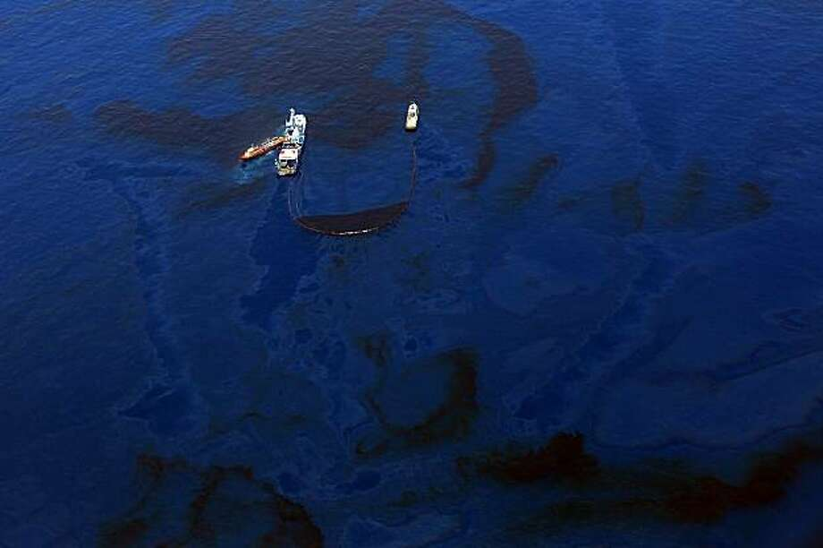 GULF OF MEXICO - MAY 29:  Crews on ships work on skimming and collecting oil near the source site of the Deepwater Horizon disaster May 29, 2010 in the Gulf of Mexico near Venice, Louisiana. BP officials indicated on Saturday that the latest attempt to plug the source of the worst oil spill in U.S. history still hasn't been successful. Photo: Win McNamee, Getty Images