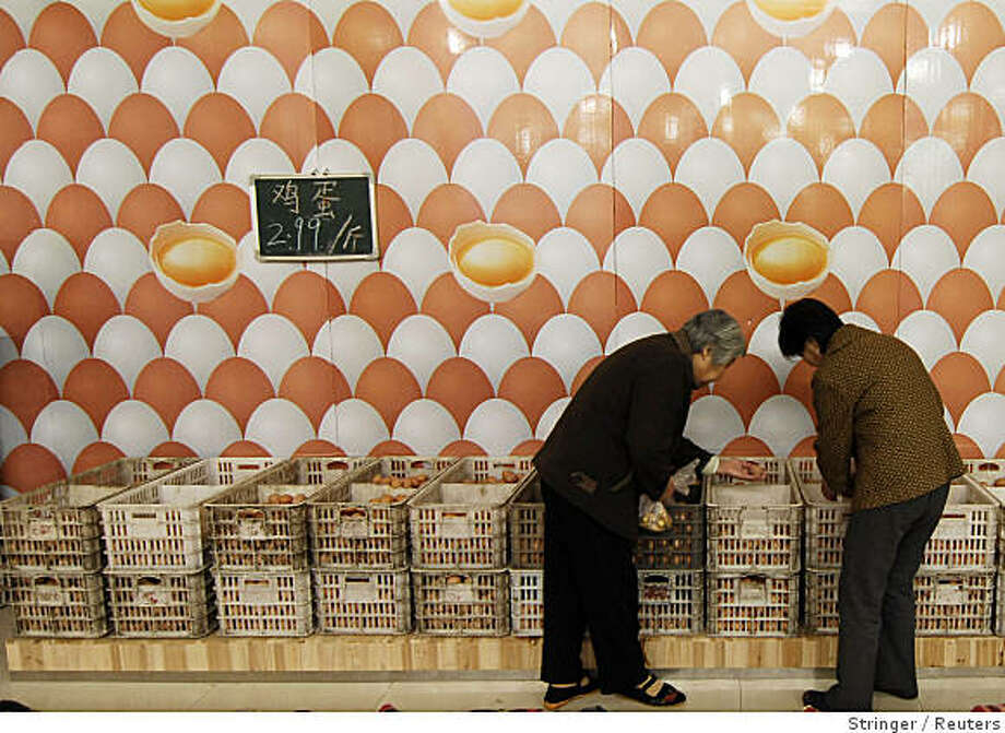Customers buy eggs at a supermarket in Xiangfan, Hubei province in this October 31, 2008 file photo. The discovery of melamine in eggs as well as in baby formula, milk products, biscuits, chocolates and other foodstuffs containing milk derivatives confirms what experts have long suspected; that the chemical is deeply embedded in the human food chain. China is a major transgressor as carcinogenic chemicals are regularly used as food colouring agents or as preservatives, experts say. To match feature CHINA-MELAMINE/FOODCHAIN  REUTERS/Stringer/Files (CHINA).  CHINA OUT. NO COMMERCIAL OR EDITORIAL SALES IN CHINA. Photo: Stringer, Reuters