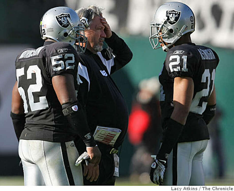 Oakland Raiders defensive coach Rob Ryan shakes his head as he talks with defensive players Kirk Morrison and Nnamdi Asomugha as they  loss against the  Atlanta Falcons, Sunday Nov. 2, 2008, at the Oakland-Alameda County Coliseum, in Oakland, Calif. Photo: Lacy Atkins, The Chronicle