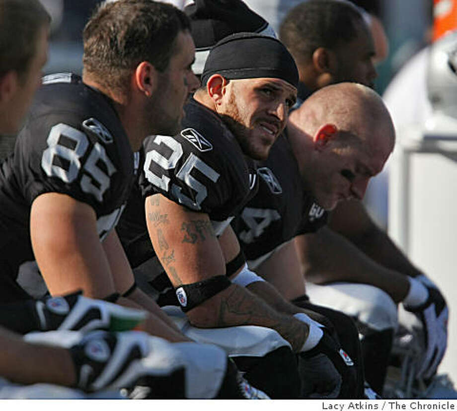 Oakland Raiders Justin Fargas, center watches the score board as they loss against the Atlanta Falcons, Sunday Nov. 2, 2008, at the Oakland-Alameda County Coliseum, in Oakland, Calif. Photo: Lacy Atkins, The Chronicle