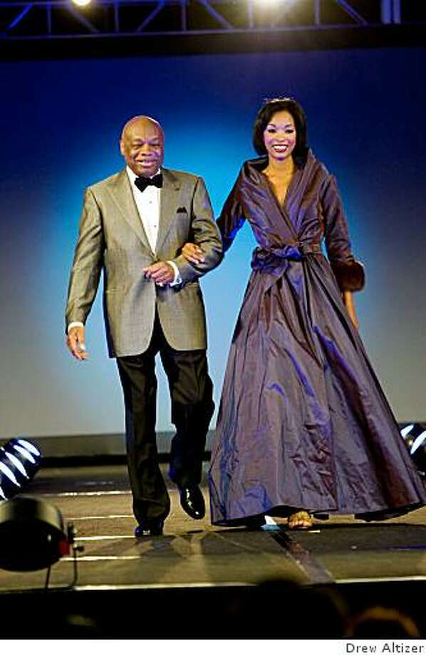 """More than 400 people attended the """"Glamour"""" fashion show by Wilkes Bashford at the Westin St. Francis on Oct 2, 2008, to raise funds for the Arthritis Foundation. Former Mayor Willie Brown models a pin dot tuxedo by Brioni with a female model in a lilac silk taffeta gown with mink fur cuffs by Catherine  Regehr. Photo: Drew Altizer"""