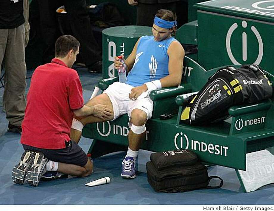 PARIS - OCTOBER 31:  Rafael Nadal of Spain receives treatment before withdrawing from his match against Nikolay Davydenko of Russia during the ATP Masters Series at the Palais Omnisports De Paris-Bercy on October 31, 2008 in Paris, France.  (Photo by Hamish Blair/Getty Images) Photo: Hamish Blair, Getty Images