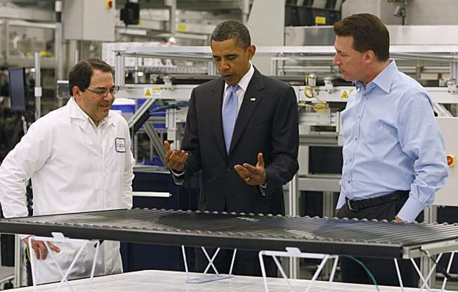 President Obama looks at a solar panel as he is given a tour of Solyndra by Executive Vice President Ben Bierman, left, and Chief Executive Officer Chris Gronet, Wednesday, May 26, 2010, at Solyndra Inc. in Fremont, Calif. Solyndra is a solar panel manufacturing facility. Photo: Paul Chinn, The Chronicle