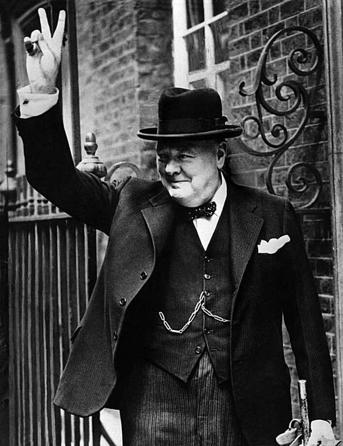 LONDON, UNITED KINGDOM: British Premier Sir Winston Churchill flashes to the crowd outside 10 Downing Street his famous V-sign signifying 'Victory' when he returned to London in 1943 from one of his trips to Washington. N/B B/W (Photo credit should read AFP/Getty Images) Photo: AFP/Getty Images