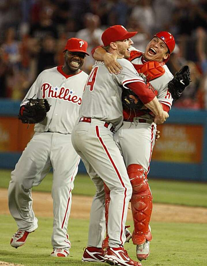 Philadelphia Phillies starting pitcher Roy Halladay, center, celebrates with Carlos Ruiz, right, and Ryan Howard after Halladay threw a perfect game during a baseball game against the Florida Marlins, Saturday, May 29, 2010 in Miami. The Phillies defeatedthe Marlins 1-0. Photo: Wilfredo Lee, AP