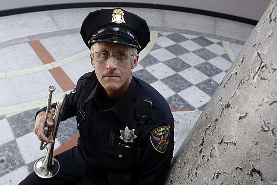SFPD patrolman Mark Lundin with his trumpet at the Bayview station in San Francisco, Calif., on Thursday, May 13, 2010.  He has been playing Taps on the trumpet at all police funerals and ceremonies, ever since one of his partners was killed 15 years ago. Photo: Liz Hafalia, The Chronicle